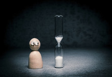 Deadline Symbol With Small Figure Watching Hourglass Countdown. Concept Of Time Pressure, Aging Alone And Business Pressure.