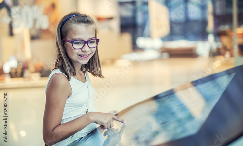 Fotografia, Obraz  Beautifull cute little girl studing orientation plan in shopping mall