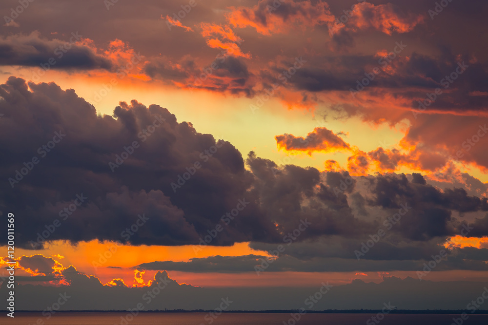 Fototapeta Abstract background of beautiful sunrise and dramatic clouds on the sky.