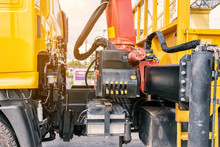 Close Up Of Crane Truck Hydraulic Control. Mechanical Levers Of