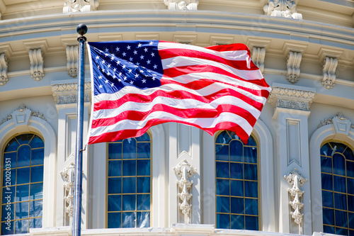 The American Flag waves in front of the Capitol building in Washington D.C.