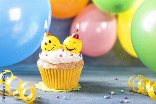 Photo  Cupcake with smile candles