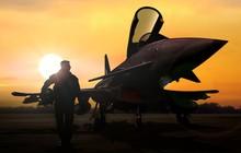 Military Pilot And Aircraft At...