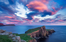 Spectacular Red Sunset Clouds Over Neist Point Lighthouse On TheIsle Of Skye