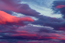 Saturated Red And Purple Clouds On Twilght Sky Background