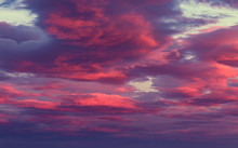 Vibrant Red And Purple Clouds On Twilght Sky Background