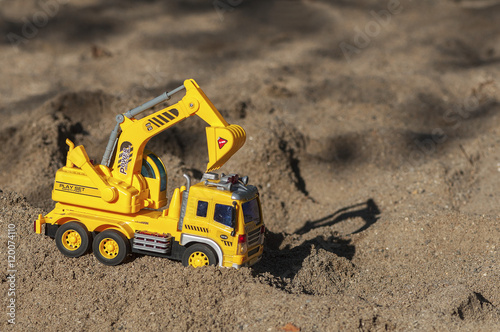 Fotografie, Obraz  Toy excavator in the sand. Children's toy