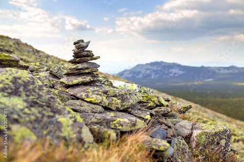 Canvas Print Granite stone cairn as a navigation mark on the top of mountain