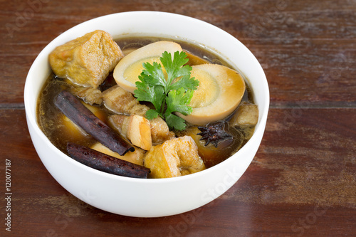 Eggs and sweet pork with fried tofu,boiled in brown sauce