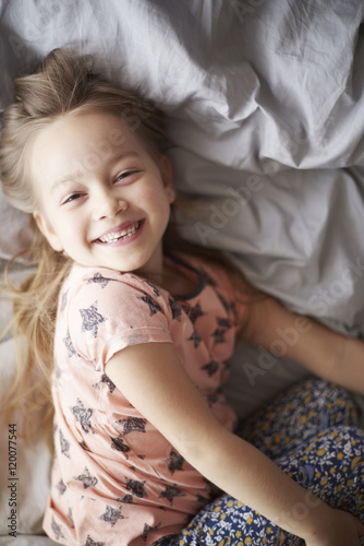 Fotografie, Obraz  Happy girl in bed in the morning