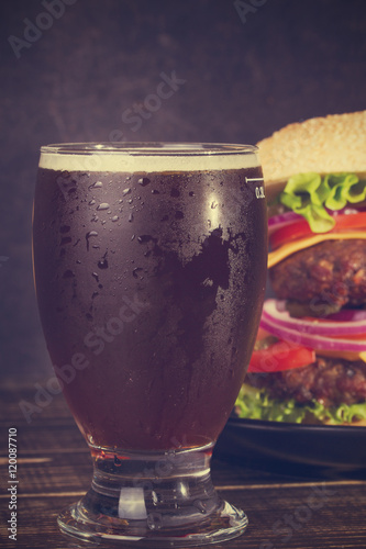 Foto op Plexiglas Cyprus Glass of Dark Beer and Delicious Burger With Beef, Tomato, Cheese, Lettuce and Onion