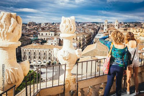 Stampa su Tela Tourists watching the panorama of the city of Catania