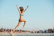 jumping woman on a bech