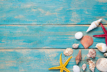 Shells And Starfishes On Blue Wooden Background. Copy Space For