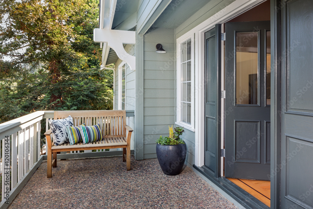 Fototapeta Entrance porch decorated with antique bench, big flower pot with