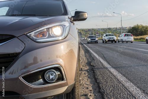 Fototapeta Modern passenger car is on the road obraz na płótnie