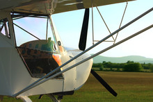 Ultralight Aircraft Close Up In Sunset With Reflection