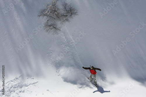 Fotografie, Obraz  Snowboarding Down the Snowy Mountain Terrain at the Ski Resort at Nevados De Chi