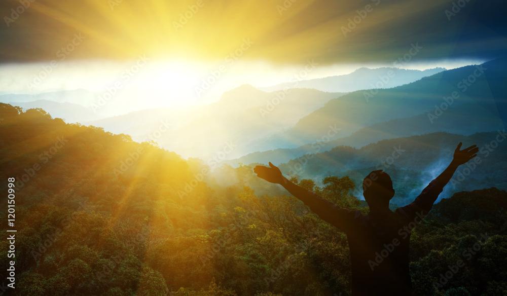 Fototapety, obrazy: The man thank God on the mountain.
