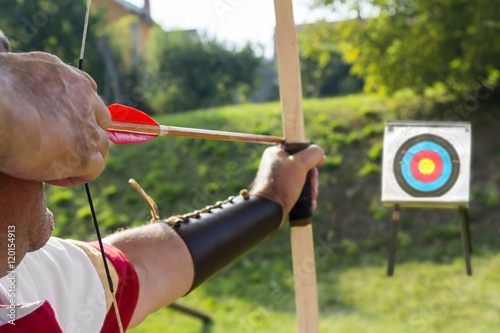 Canvas Medieval archer shoot at a target