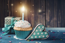 Cupcake With Birthday Candle And Gift Box