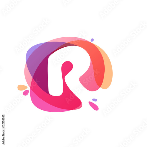 Photo  Letter R logo at colorful watercolor splash background.