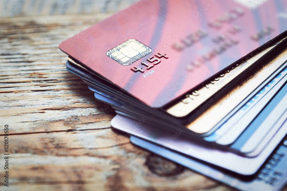 Fototapeta Set of color credit cards on wooden table