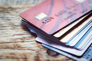 Set of color credit cards on wooden table