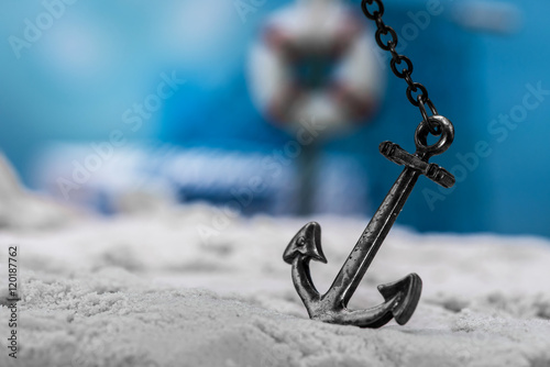 Leinwand Poster vintage anchor on the beach