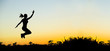 Happiness - happy jumping female silhouette at sunset