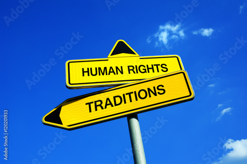 Fotografie, Obraz  Human Rights or Traditions - Traffic sign with two options - collision between western values and cultural and religious traditions like female genital mutilation