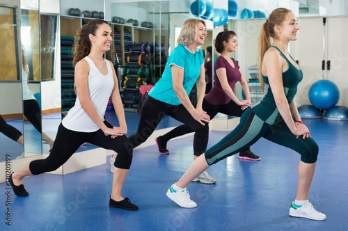 Fotografie, Obraz  Positive females working out at aerobic class in modern gym