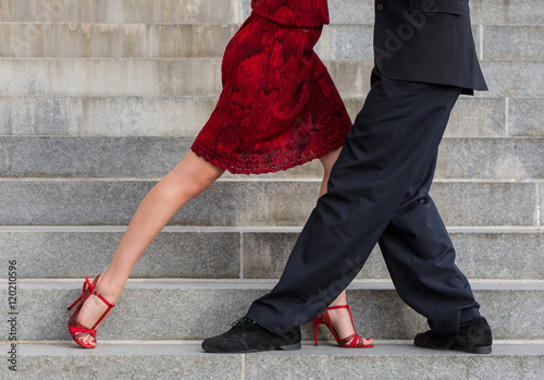man and woman dancing tango on street staircase Canvas Print