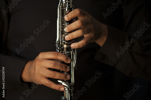 Hands of a clarinet player in black Wallpaper Mural