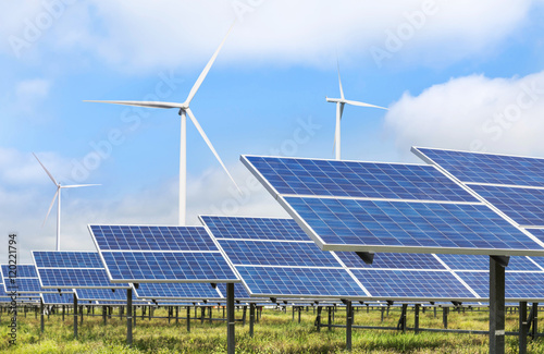 solar photovoltaics  panel and wind turbines generating electricity green energy Fototapet