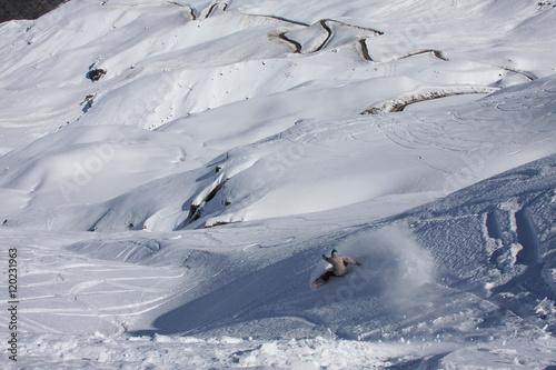Fotografie, Obraz  Valle Nevado, Chile: Snowboarding Landscape View as a Snowboarder Slashes Some F