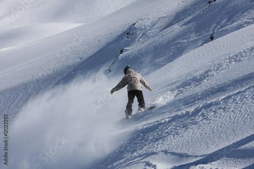 Fotografie, Obraz  Snowboarding Downhill at a Ski Resort in Valle Nevado, Chile
