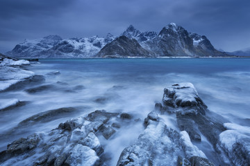 Fototapeta Zima Dark clouds over a fjord in Norway in winter