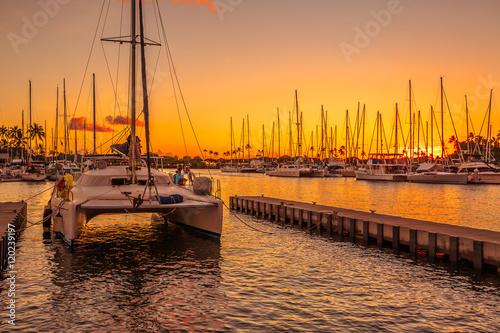 Canvas Print Catamaran docked at the Ala Wai Harbor at sunset