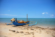 Beautiful beach and boat under blue sky