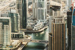 Modern city architecture in summer. Aerial skyline of Dubai Marina, UAE. View over the harbor.