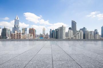 cityscape and skyline of shanghai from empty brick floor