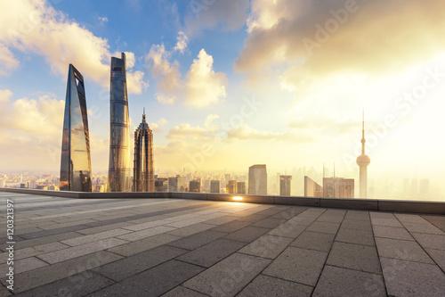 Photo  cityscape and skyline of shanghai from empty brick floor