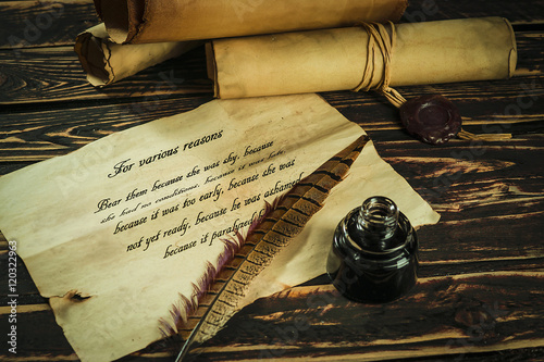 Photographie Roll of parchment with a pen and inkwell