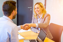 Young Attractive Woman Handshaking At The End Of A Job Interview