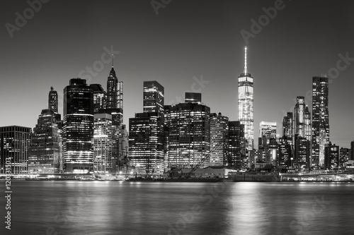 Fototapety, obrazy: Black & White East River view of Financial District skyscrapers at dusk. Lower Manhattan skyline, New York City