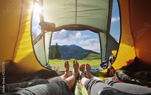 Poster Miel Two people lying in tent with a view of mountains. Carpathians.