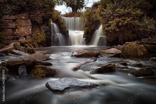 Foto op Canvas Watervallen Long exposure of the waterfalls at Penllergare woods, Swansea, UK
