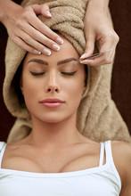 Women Having Treatment Plucking Eyebrows