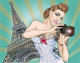 Fototapeta Paryż - Pin-up sexy woman takes pictures on camera near Eiffel Tower in Paris